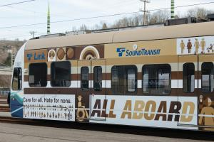 "A Link train is wrapped in an advertisement that reads: ""Care for all. Hate for none. All aboard."""