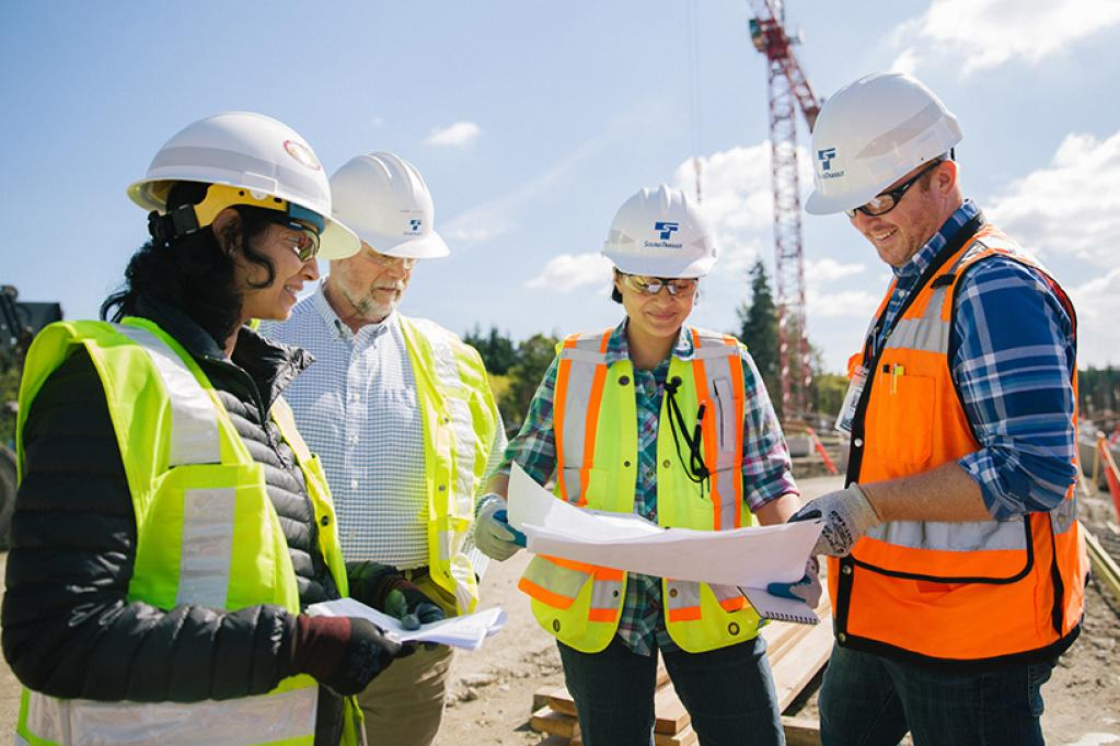 Lynnwood Link Extension construction team reviewing plans