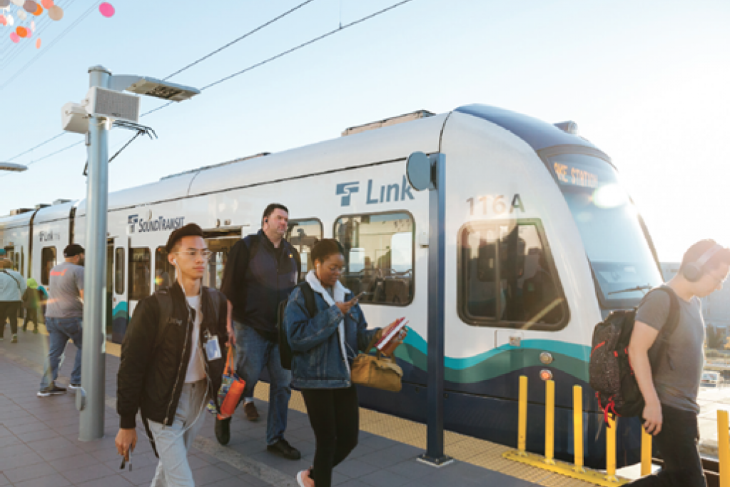 Tacoma Dome Link Extension project update header, image of riders exiting the train