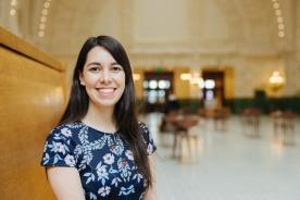 Sound Transit intern Asela Chavez-Basurto smiles in the Great Hall at Union Station.